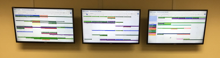3 consecutive month calendar views are displayed on large tv screens.